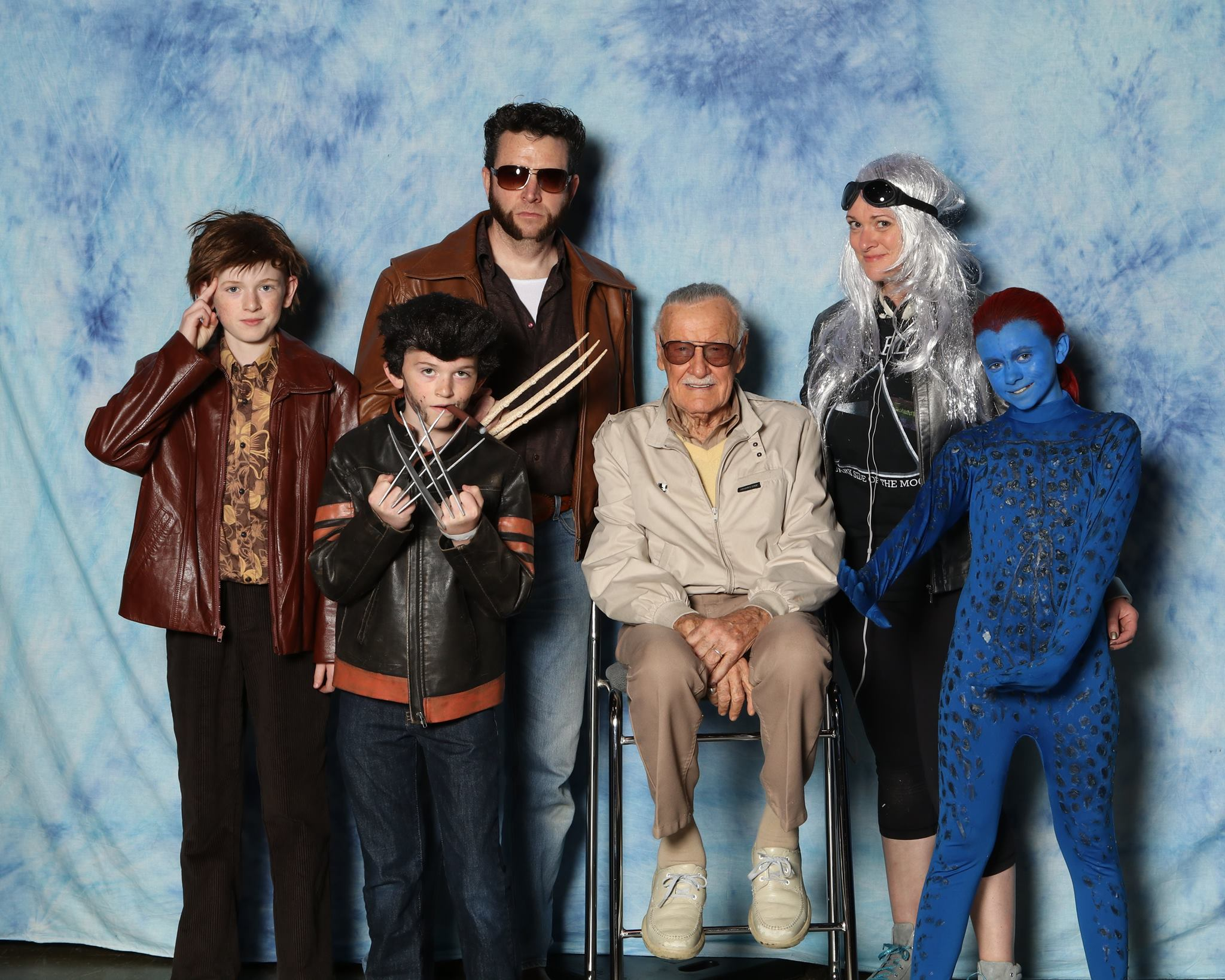 THE DONNELLY FAMILY COSPLAYS AT THE FAN EXPO, TAKING A PHOTOGRAPH WITH STAN LEE (MIDDLE).  Photo courtesy of Michelle Donnelly.