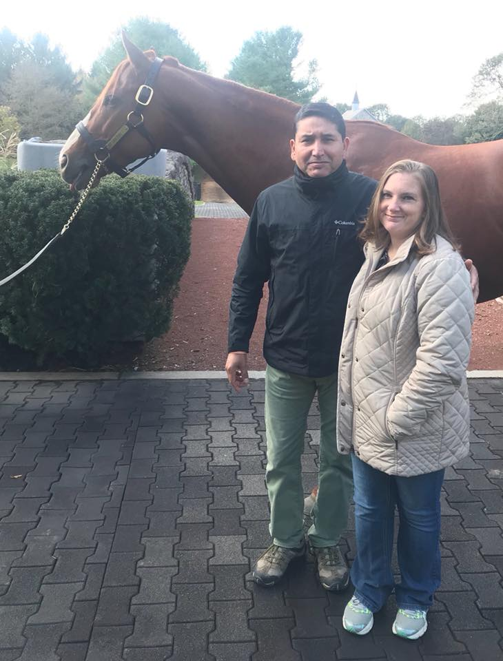 Hannah and Esteban with triple crown winner Justify