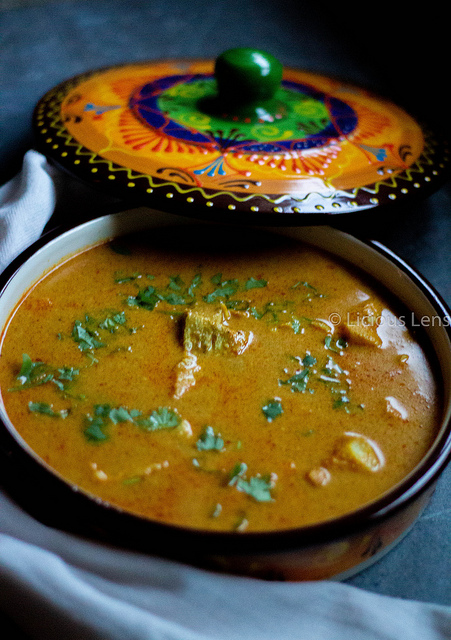 Goan Fish Curry - Goa is one of our favorite places in India and we do have a lot of memories. Food memories being the most cherished. If you go to goa you should not comeback without having the Goan fish curry � So here's presenting you all the most popular Goan fish curry. Goan Fish Curry is an authentic curry recipe prepared using coconut, chillies, masalas and any kind of firm fish. It is a flavourful recipe that tastes best when paired with steam rice. Wet masala:5-6 red dried chillies, soaked in water1/2 cup fresh Coconut, sliced1 tbsp Tamarind Paste1 inch fresh Ginger, peeled & chopped3 Garlic cloves½ medium sized Red Onion, sliced¼ tsp Turmeric Powder¼ tsp Cumin seeds¼ tsp Black Pepper1 tsp Coriander Seeds1/2 medium onion choppedWater for grindingTempering:1lb any firm fish slices- i used alaskan cod2 cups waterSalt as required2 green chillies slitMethod of preparation:For Marination:To the fish Add some turmeric, salt to it and rub the fish on either side.Massage it well and ensure that you fill in all the cuts and gashes.For the masala:In a mixer jar add sliced coconut, red chillies, coriander seeds, garlic, peppercorns, cumin seeds, onion, green chillies, ginger and grind them.After running it in the grinder for few seconds, scrape the sides off, add tamarind and water. Grind it into a fine paste.Heat a vessel, transfer the paste into it and add in water.Increase the flame and add salt to the curry, give it a good mix.Cover it with a lid and cook it for 10 minutes.Add in the marinated fish, splash the curry on top of the fish, cover it with a lid and cook it for next 8-10 minutes.Add in few slit green chillies and now its ready to plate.Our Goan Fish Curry is ready. #foodtalesofindia #goanfishcurry#goanfood