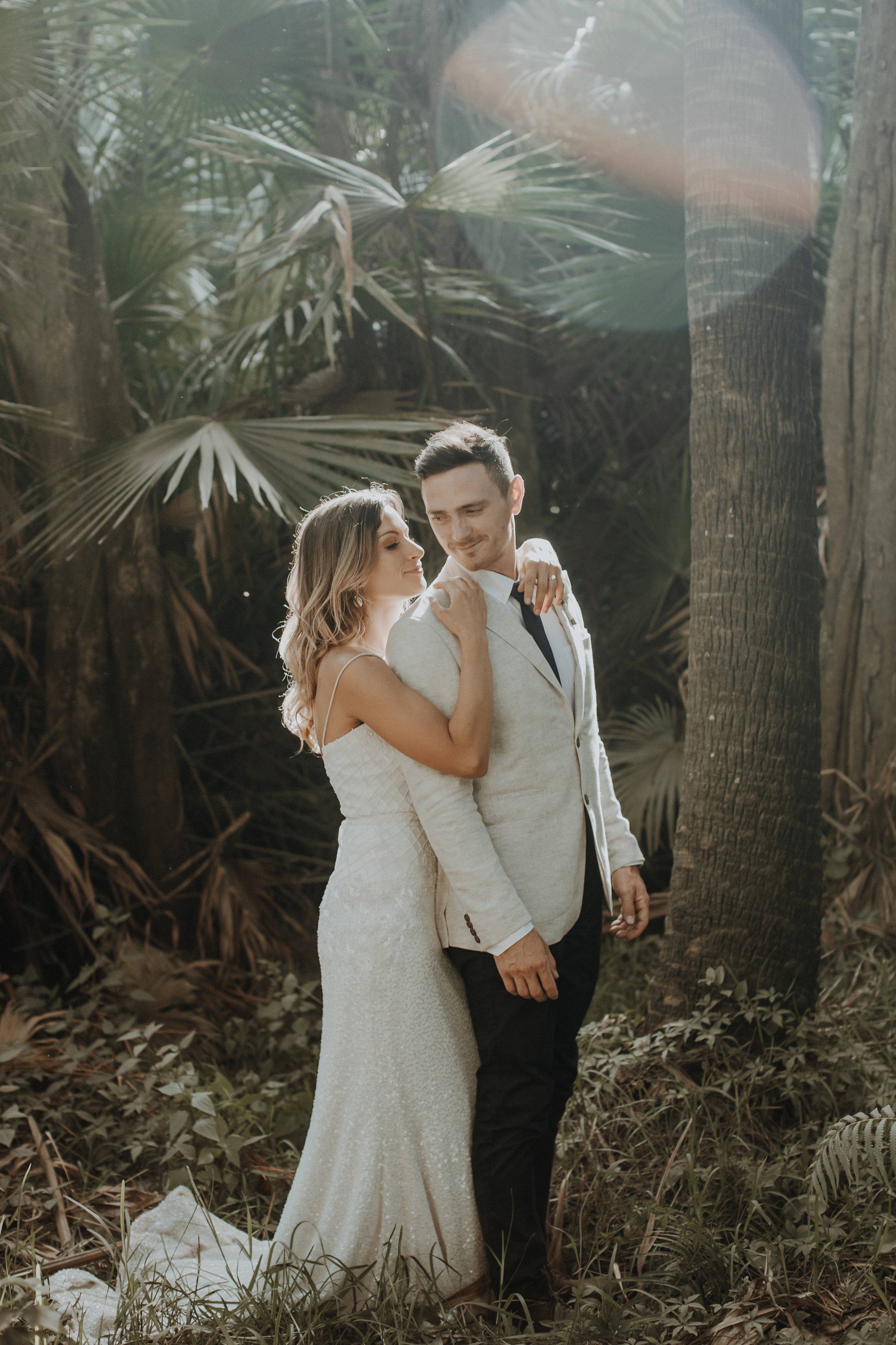 wedding photographer with sunset couple at hunter valley outside newcastle new south wales