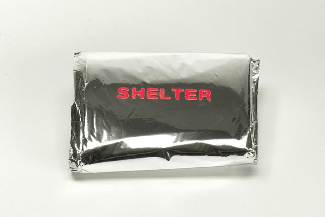 S H E L T E R / Elizabeth Azen, 2005.  Emergency blanket. Mylar, laser cut vinyl.
