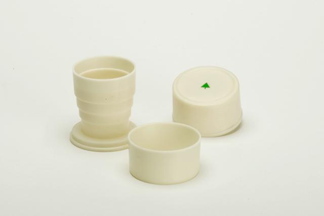 H Y D R A T I O N / Elizabeth Azen, 2005.  Collapsible cup, set of 2. Plastic, laser cut vinyl.