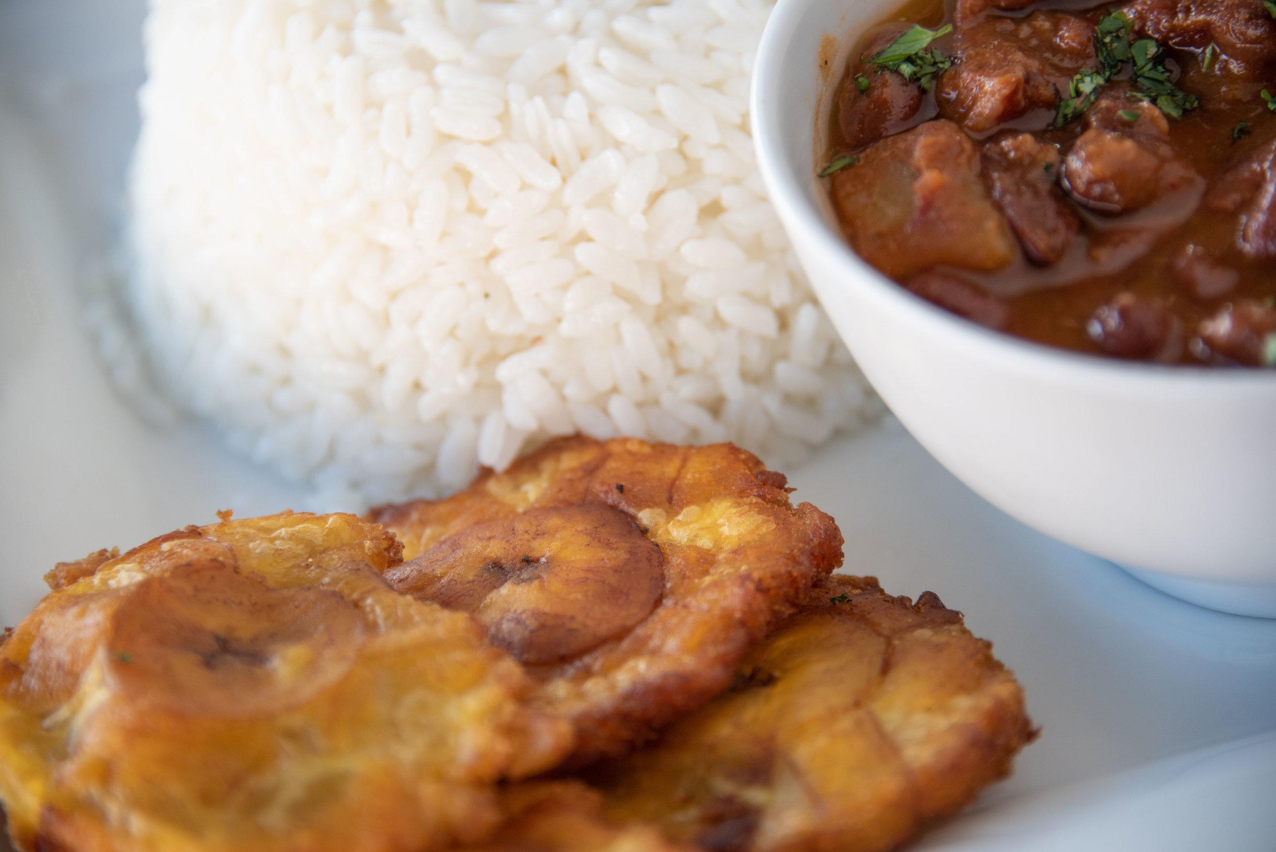 Warm bowl of Habichuelas, crispy Tostones and Arroz Blanco