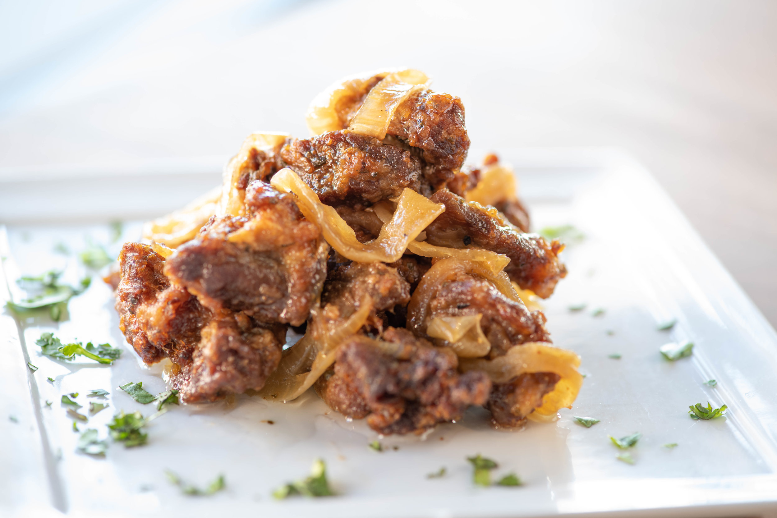 Carne Frita- Fried Pork Chunks marinated in Puerto Rican spices and Red Wine Vinegar