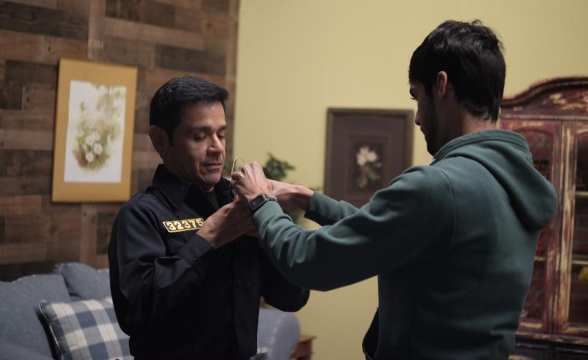 - Actor, Gerardo De Pablos putting on his mic with Sound Mixer, Marcos Castro.