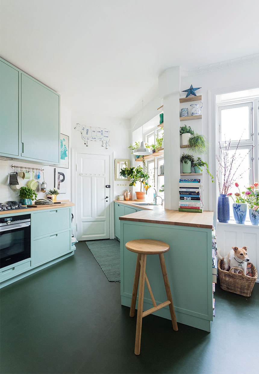 This kitchen feels so fresh. The light blue cabinets and the natural light flooding in make this so lovely | photo by  Andreas Mikkel Hansen