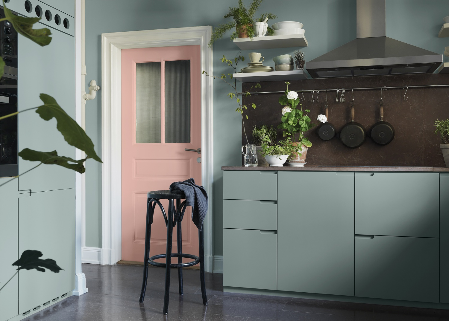 I think the cabinets are already on the neutral side in this kitchen, but in combination with that pink door it just elevates this kitchen into something special | design by  Saša Antić