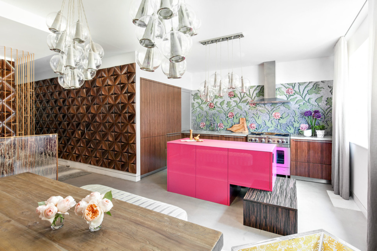 You can't go much brighter pink than this! And that floral wall just makes this kitchen extra special. Though I must say it's a good thing that the other cabinets are more neutral otherwise this might have blind you | design by Elizabeth Bomberger & photo by  Regan Wood