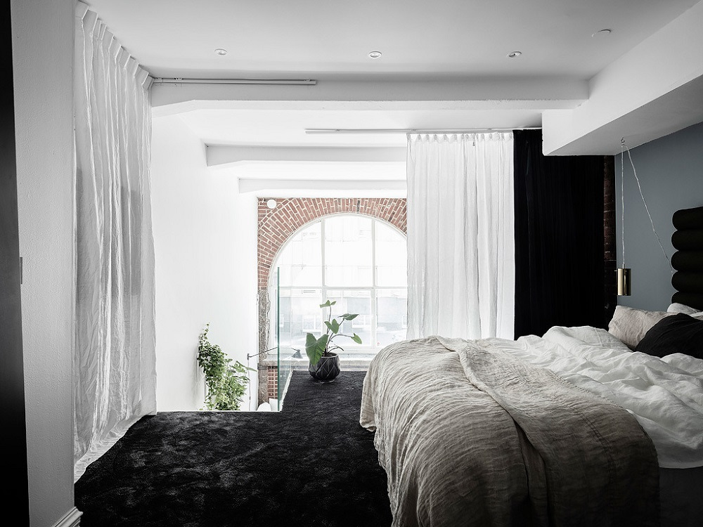 Exposed brick in a Scandinavian loft apartment    | photos by Anders Bergstedt
