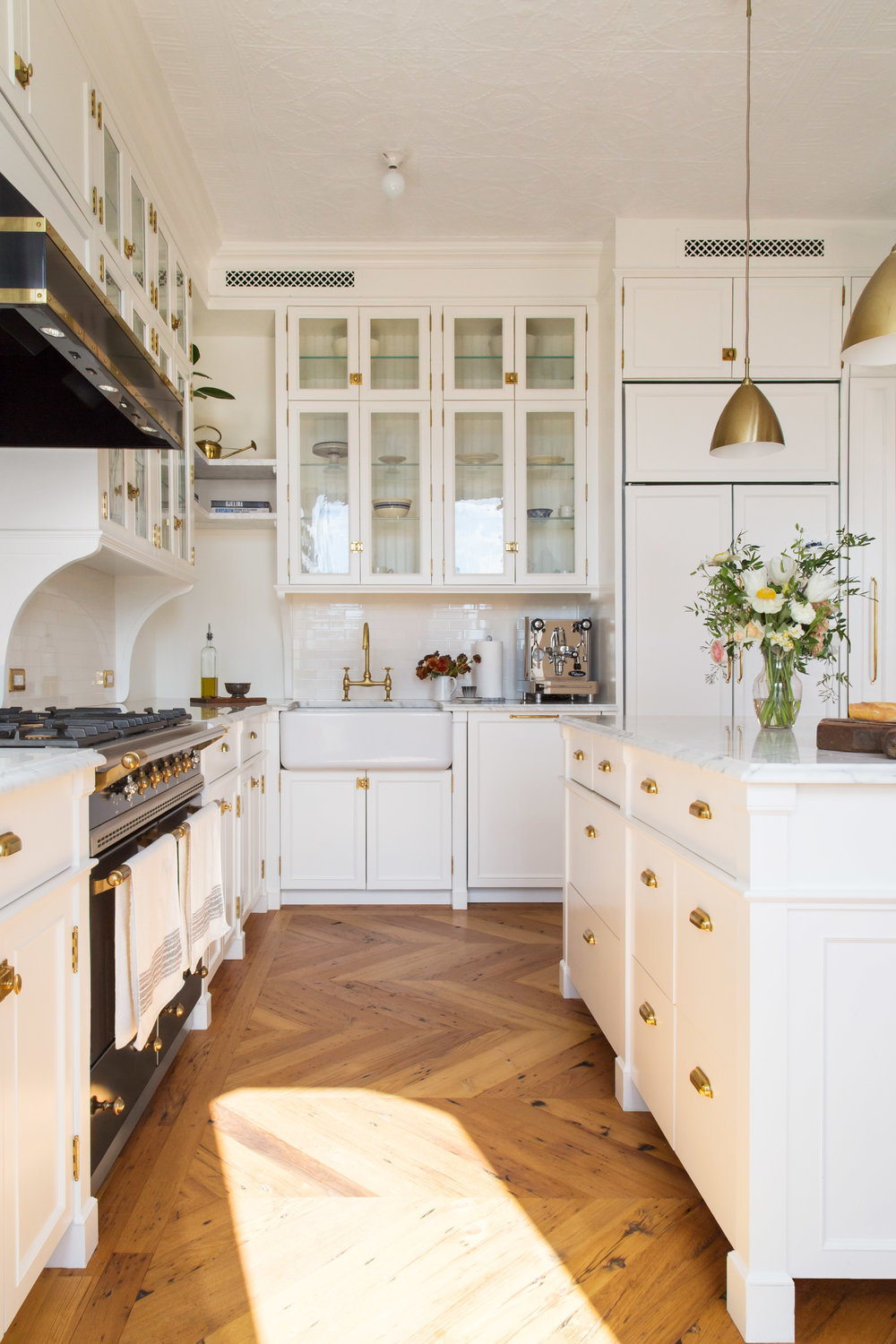 White kitchen in a Williamsburg penthouse | design by Space Exploration