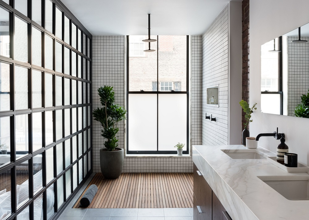 Love the wooden floor in this bathroom in an industrial SoHo loft | photo by Claire Esparros