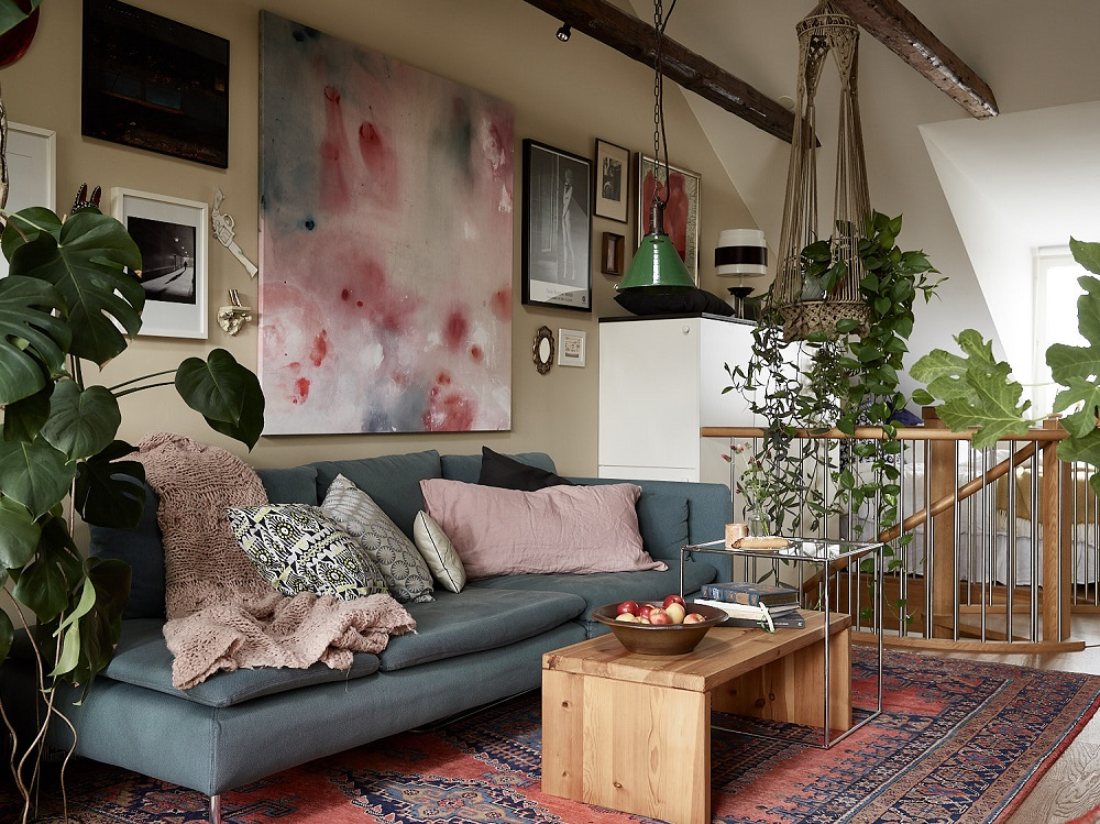 A wonderful plant-filled attic living room in Stockholm | styling by Åsa Copparstad & photos by Johan Spinnell