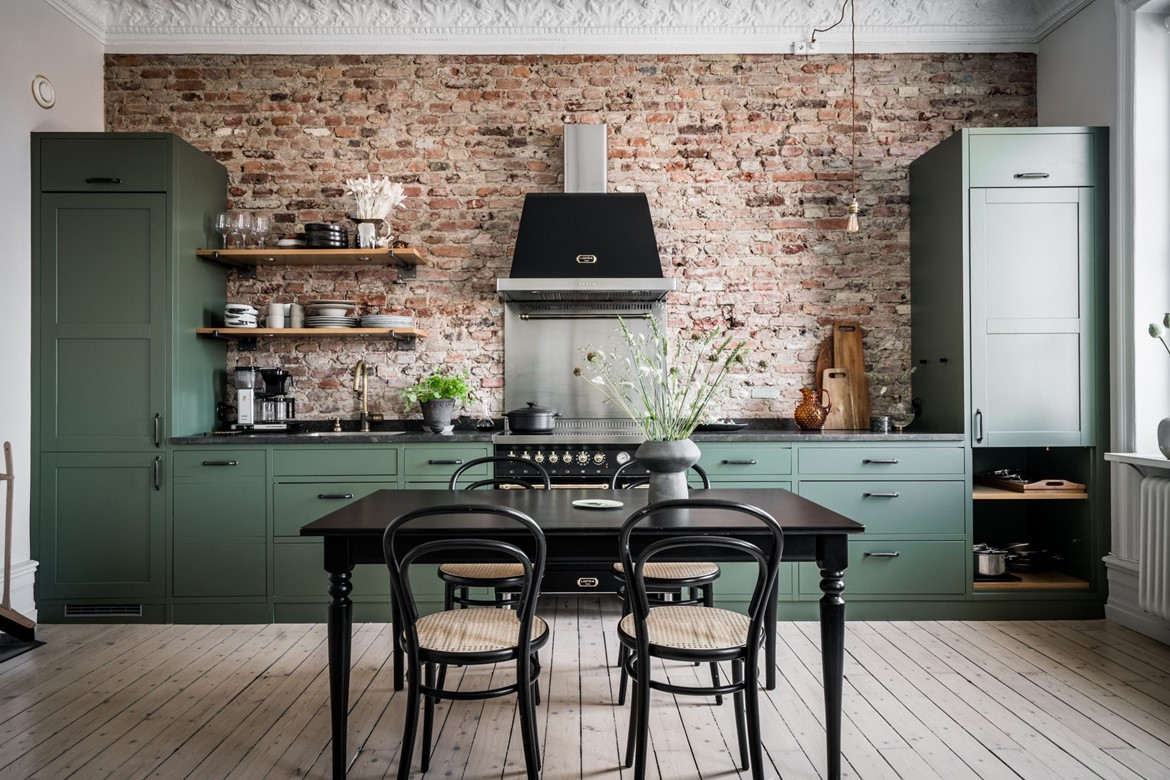 The Nordroom - A Swedish Apartment With A Green Kitchen and Exposed Brick