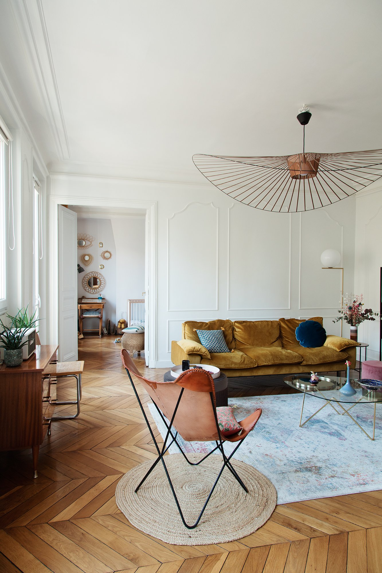 HK Living sofa in a    Parisian apartment    (photography by Eve Campestrini)