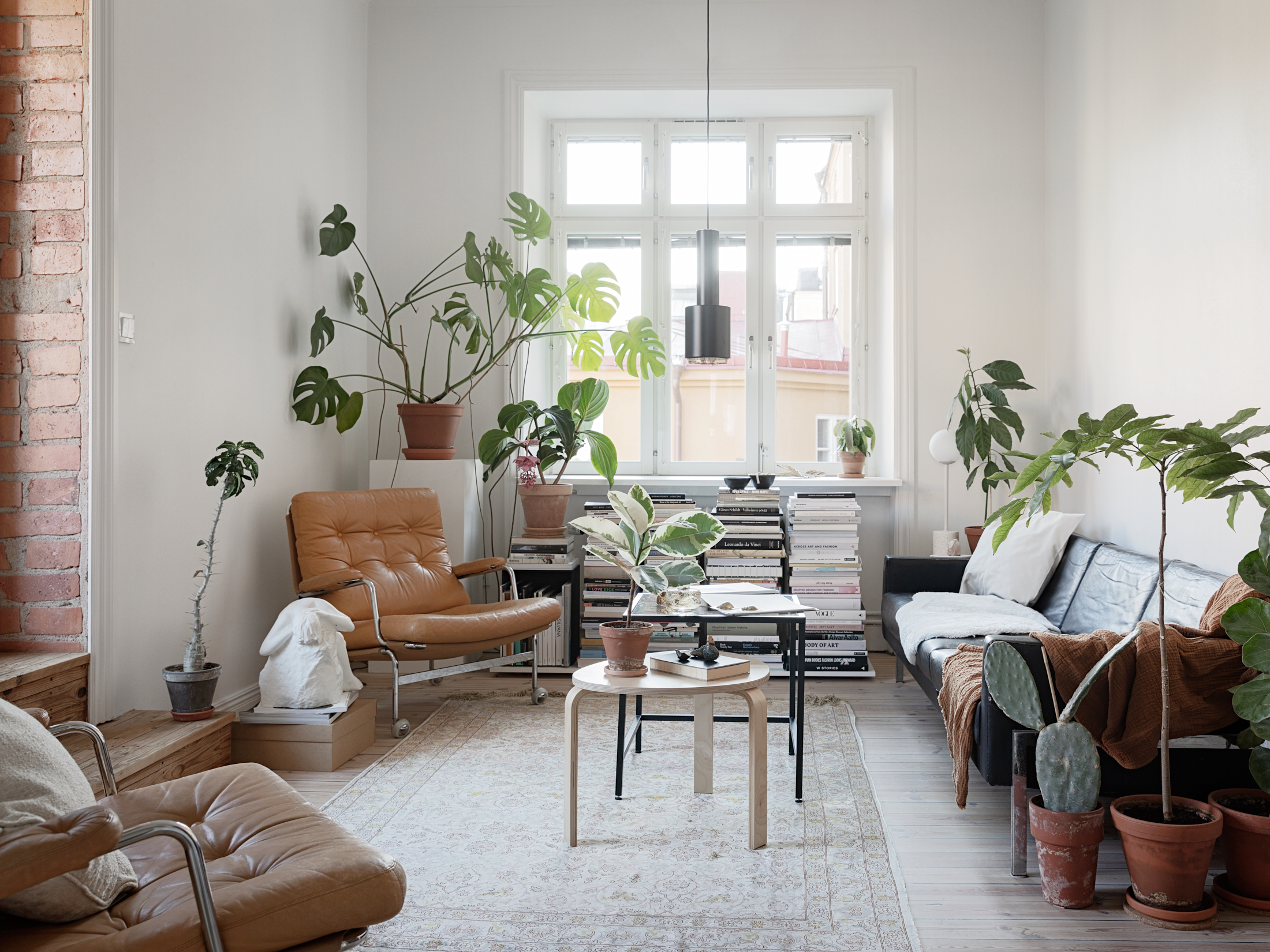 The Nordroom - A White Plant-Filled Scandinavian Apartment 1.jpg