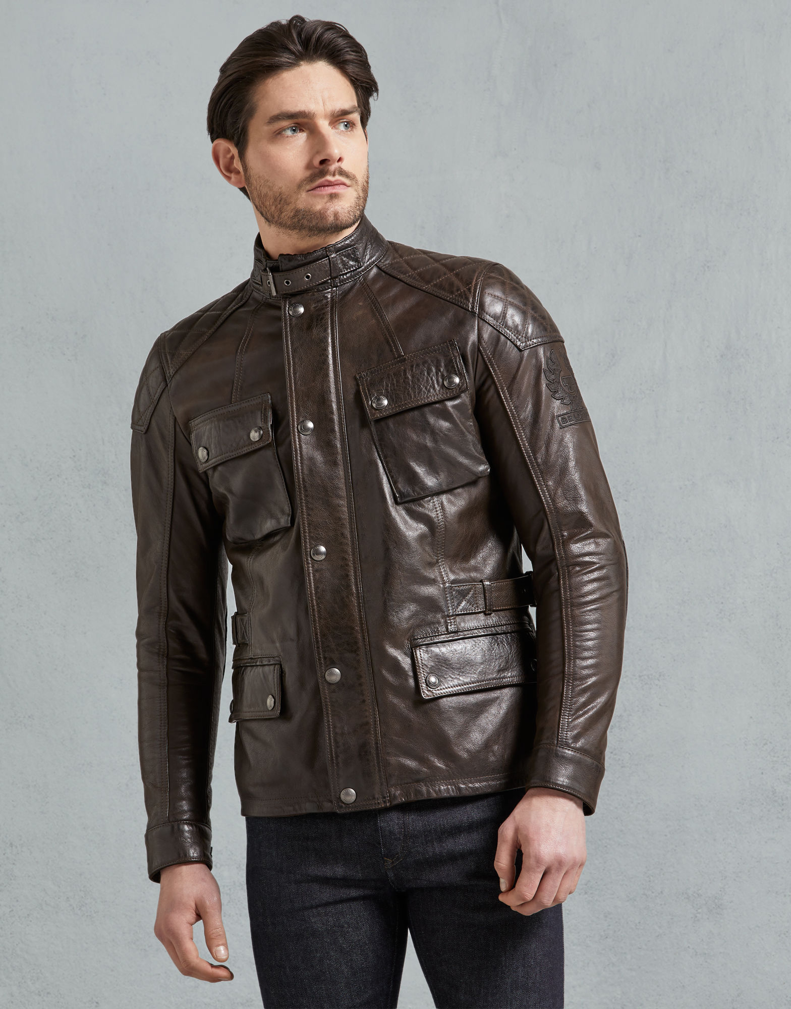 Turner Leather Jacket - Crafted from heritage, hand-waxed leather with Belstaff's exclusive artisan finishing, the Turner, in black brown, is a Pure Motorcycle icon. As well as looking the part, the Turner comes with CE-compliant D30 protectors on the shoulders and elbows.A classic four-pocket style, with press-stud closures and signature tilted map pocket, the Turner also features adjustable straps at the collar and waist for a comfortable, custom fit. Finally, the corduroy lining on the collar and cuffs adds a touch of luxurious comfort where it's needed most.Style# 41051009L81N0337-Black brown