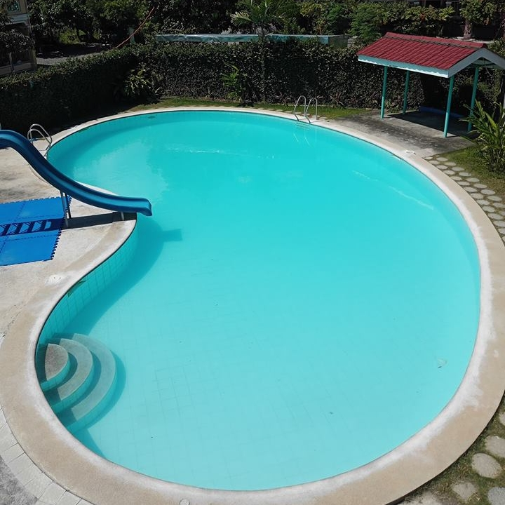 Swimming Pool - A dip in our swimming pool will make it seem like summer all year round! A favorite for family reunions and children birthday parties, be sure to get your reservations in before it's completely booked.Hours:Weekdays from 8:00 AM up to 7:00 PMWeekends from 8:00 AM up to 1:00 PMHalf day slots are also available while Swimming Pool/Function Hall Packages are discounted. For more details, reach out to us using the Make A Reservation button below.