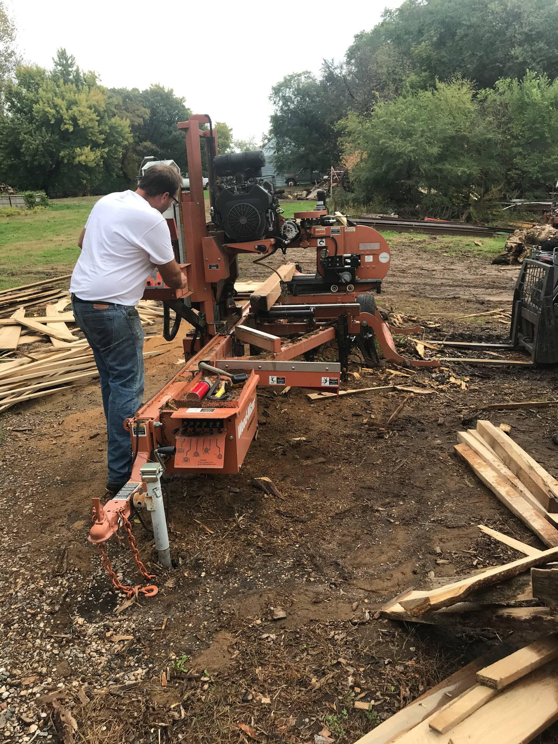 A son of the congregation milling wood for a mantle to be used for a fireplace! The wood was a free gift! And it came from the land of a family the recipient has known for years. Black walnut! What a blessing. It will bless the home of the recipient for many years.