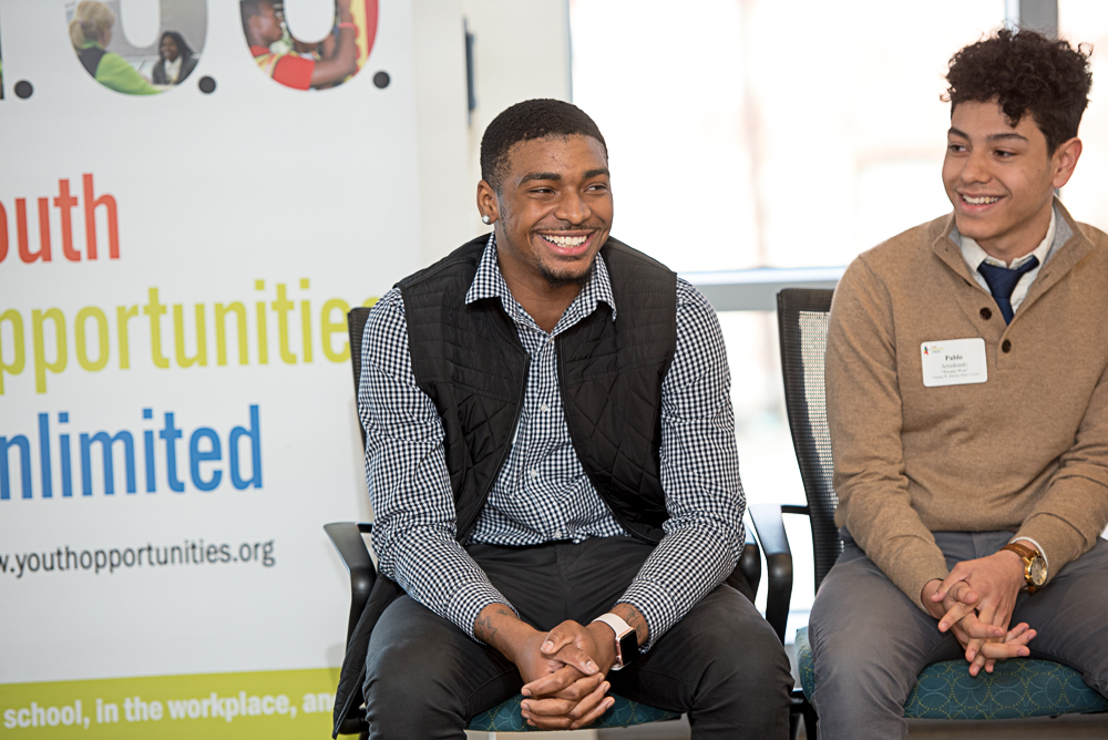 2-male-students-seated-smiling-1.jpg