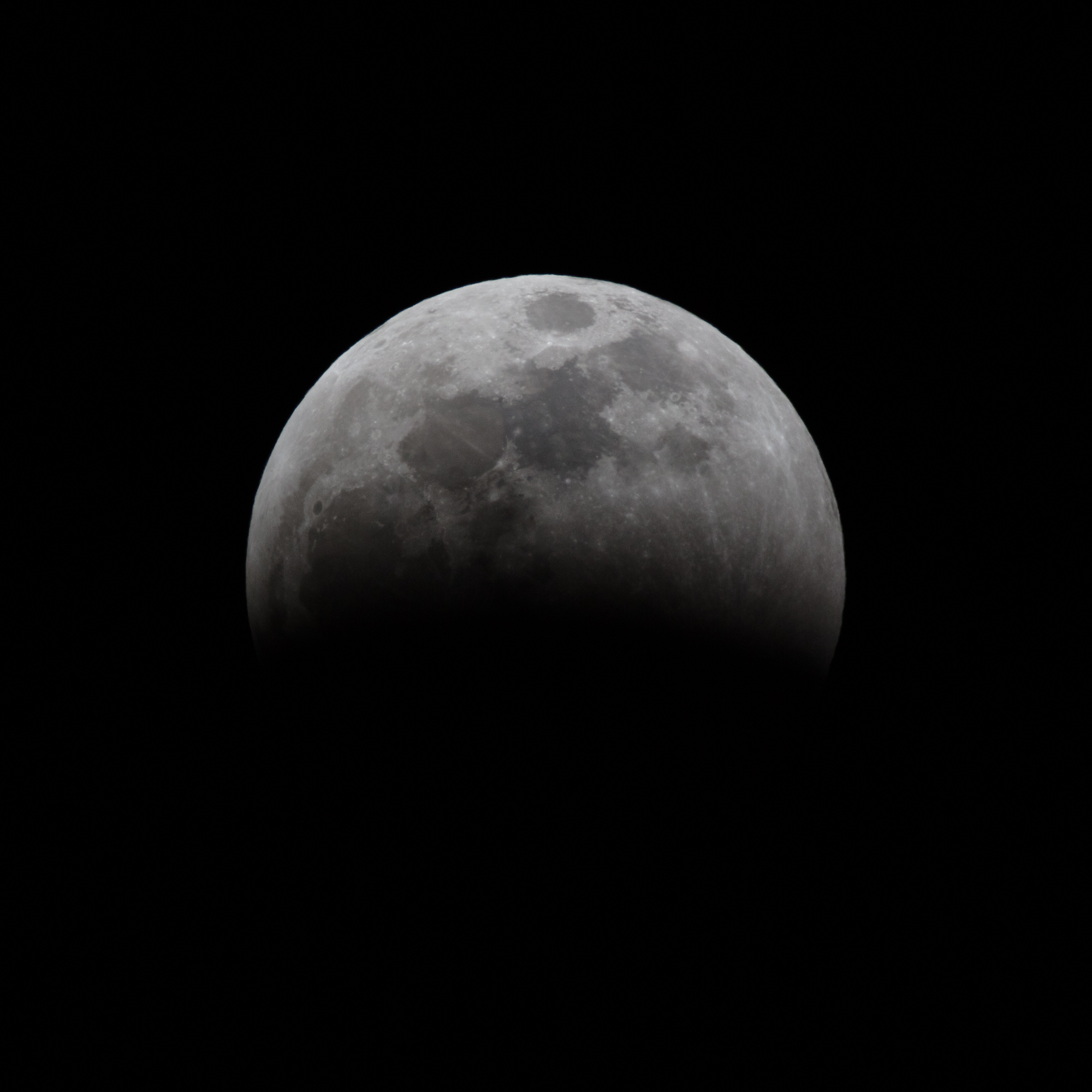 Partial eclipse moving quickly towards full lunar eclipse.