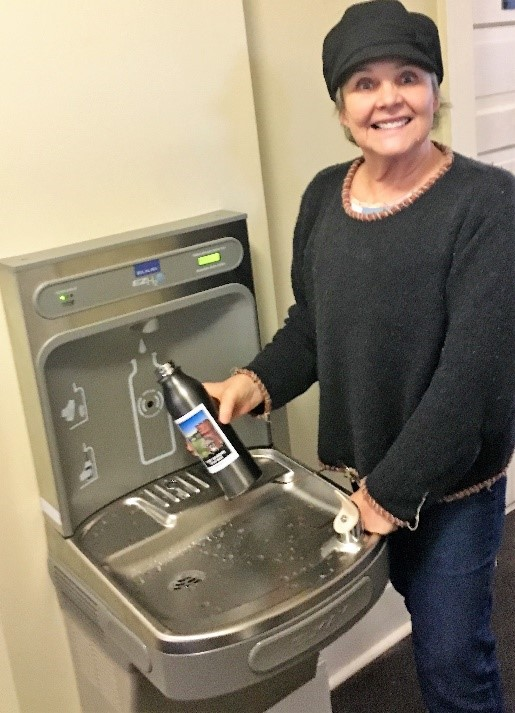 FFW Gift Shop Manager Lindy Adelmann at the new water bottle filling station in Building 200