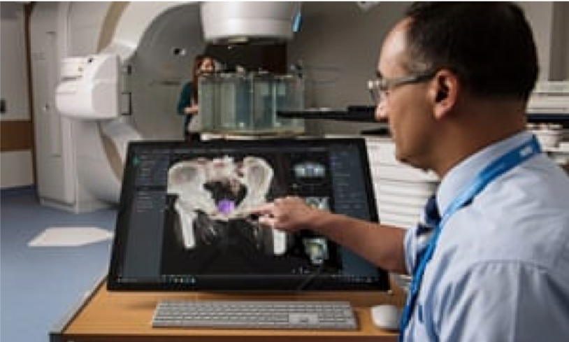Dr Raj Jena uses a Microsoft system called InnerEye to mark up scans automatically for prostate cancer patients. Photograph: Linda Nylind/Microsoft Project InnerEye Study