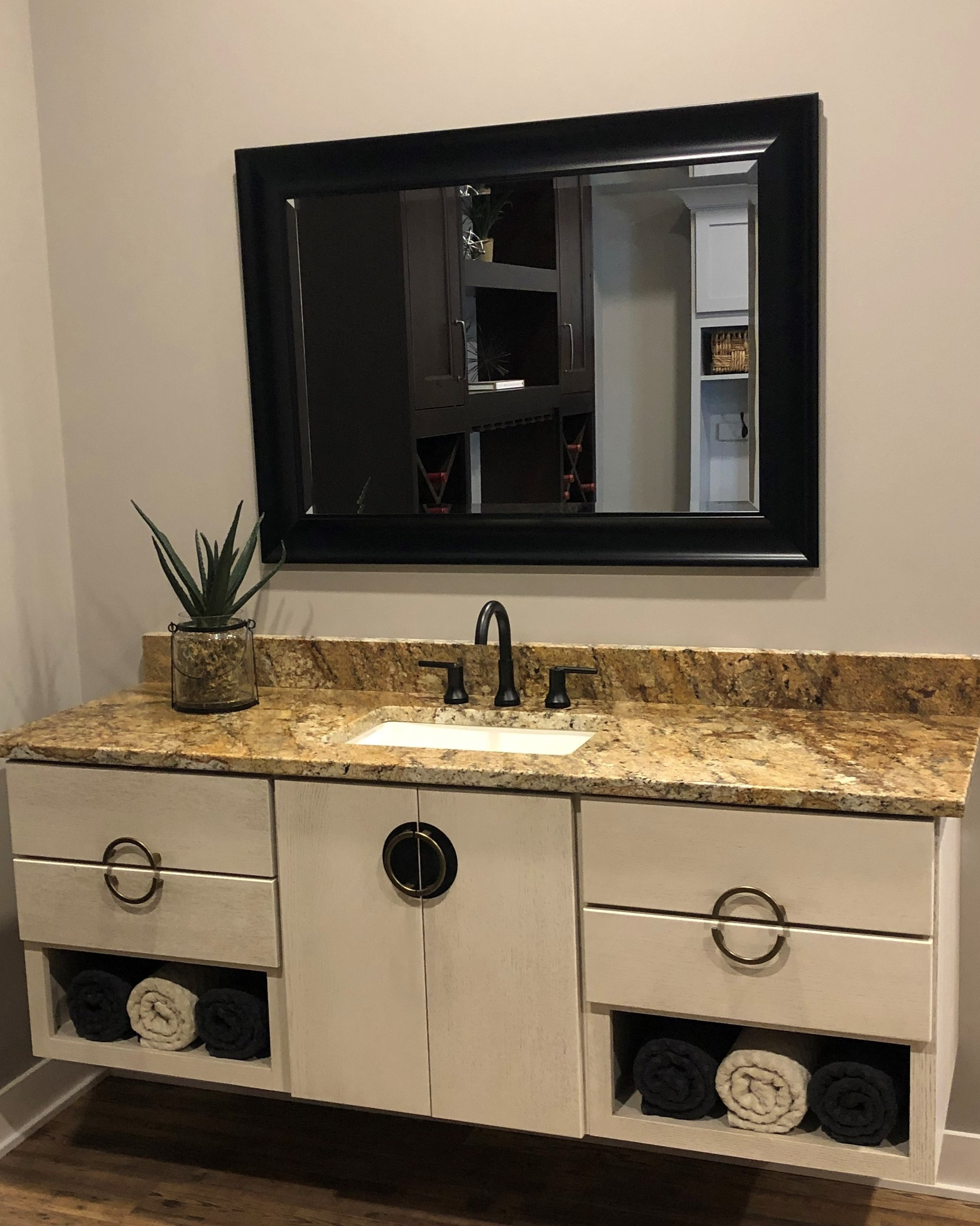 Bathroom Vanity - StarMark Cabinetry - Tempo door style in Quarter Sawn Oak finished with Macadamia tinted varnish with Chocolate Glaze