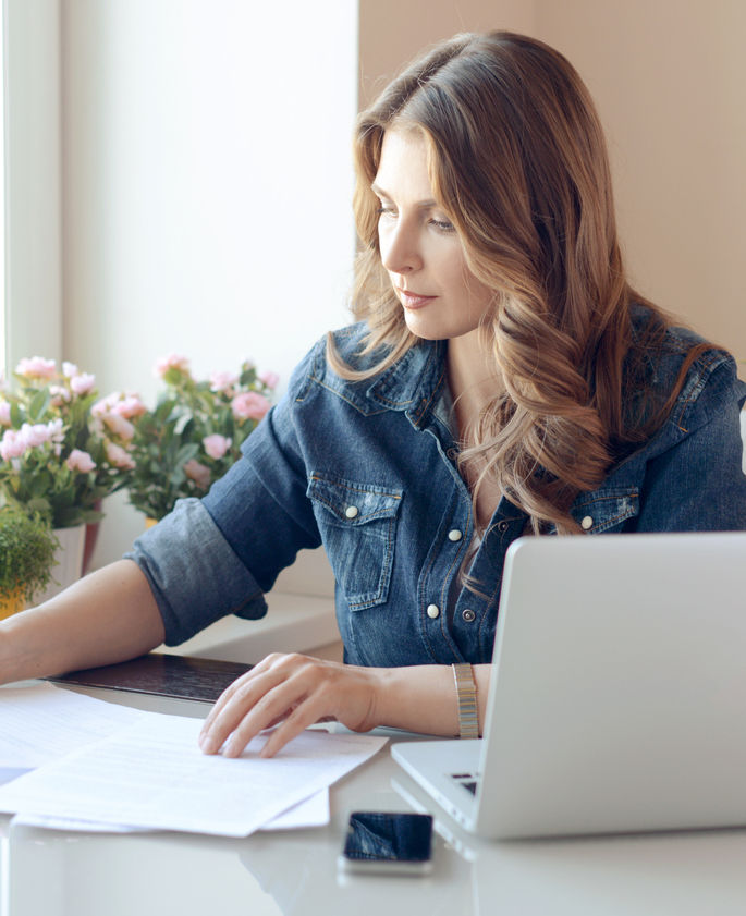 woman working on tax preparation