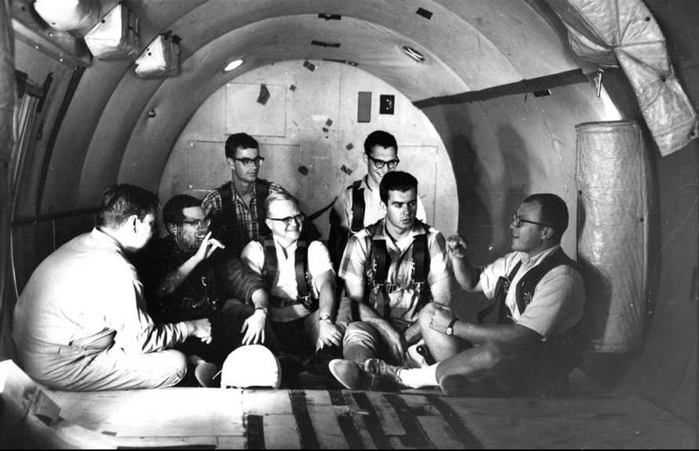 Study participants chat in the zero-g aircraft that flew out of Naval Air Station in Pensacola, Fla.  Credits: U.S. Navy/Gallaudet University collection