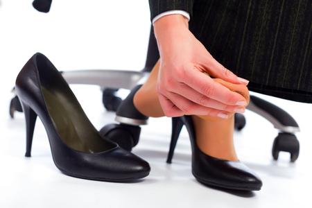 26421120_S_high_heels_woman_office_business_foot_pain_chair_sitting.jpg