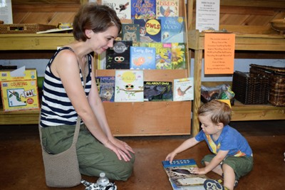 Kids' Corner - Books, play area, and activities for children. Find them inside the Visitor's Barn. Each month a topic related to gardening is explored for hands-on learning in the garden or at home.