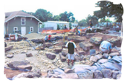 Excavation and boulder placement for Water Feature.