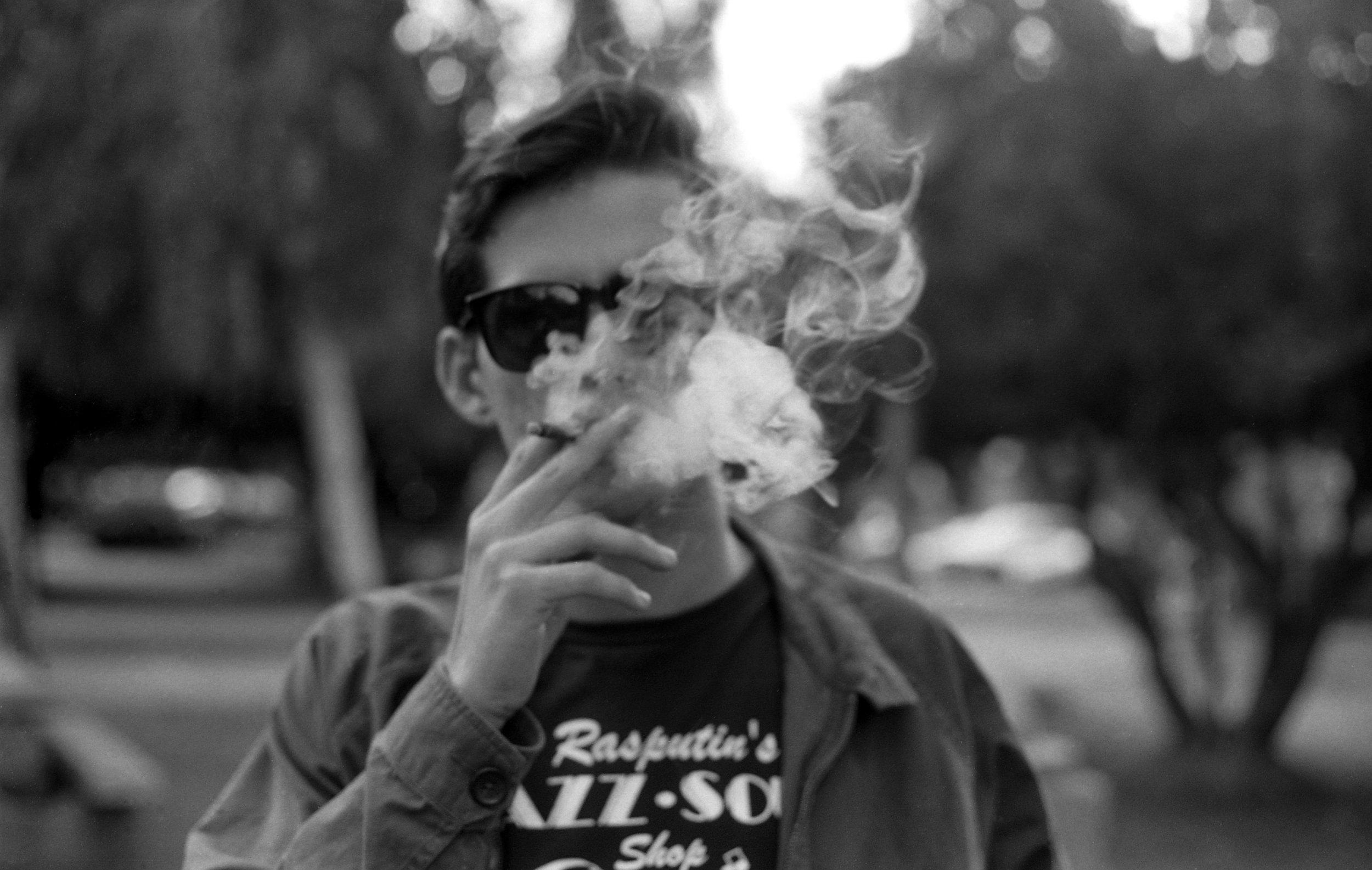 Close friend puffing cigarette
