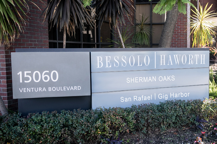 Bessolo Haworth signage outside of its Sherman Oaks office. Links to Get in Touch page.