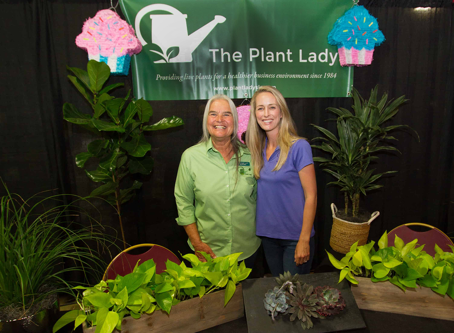 The Plant Ladies:  Kathy Longacre, Founder (left) and Samantha Young, Owner & Operator (right) at the 2019 San Luis Obispo Chamber Expo.  The Plant Lady has been a member of the San Luis Obispo Chamber of Commerce since 1985.