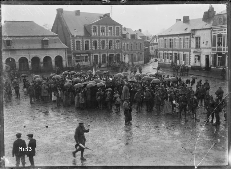 Crowd around a New Zealand regimental band playing in Le Quesnoy, the day after its capture.