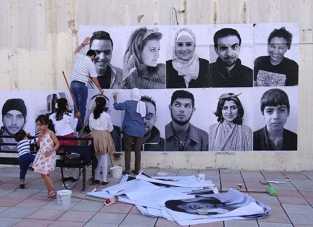 """Pictured above: """"We are Arabs, We are humans"""" Group Action in Irbid, Jordan, June 2015. Photo by Camlacaze."""