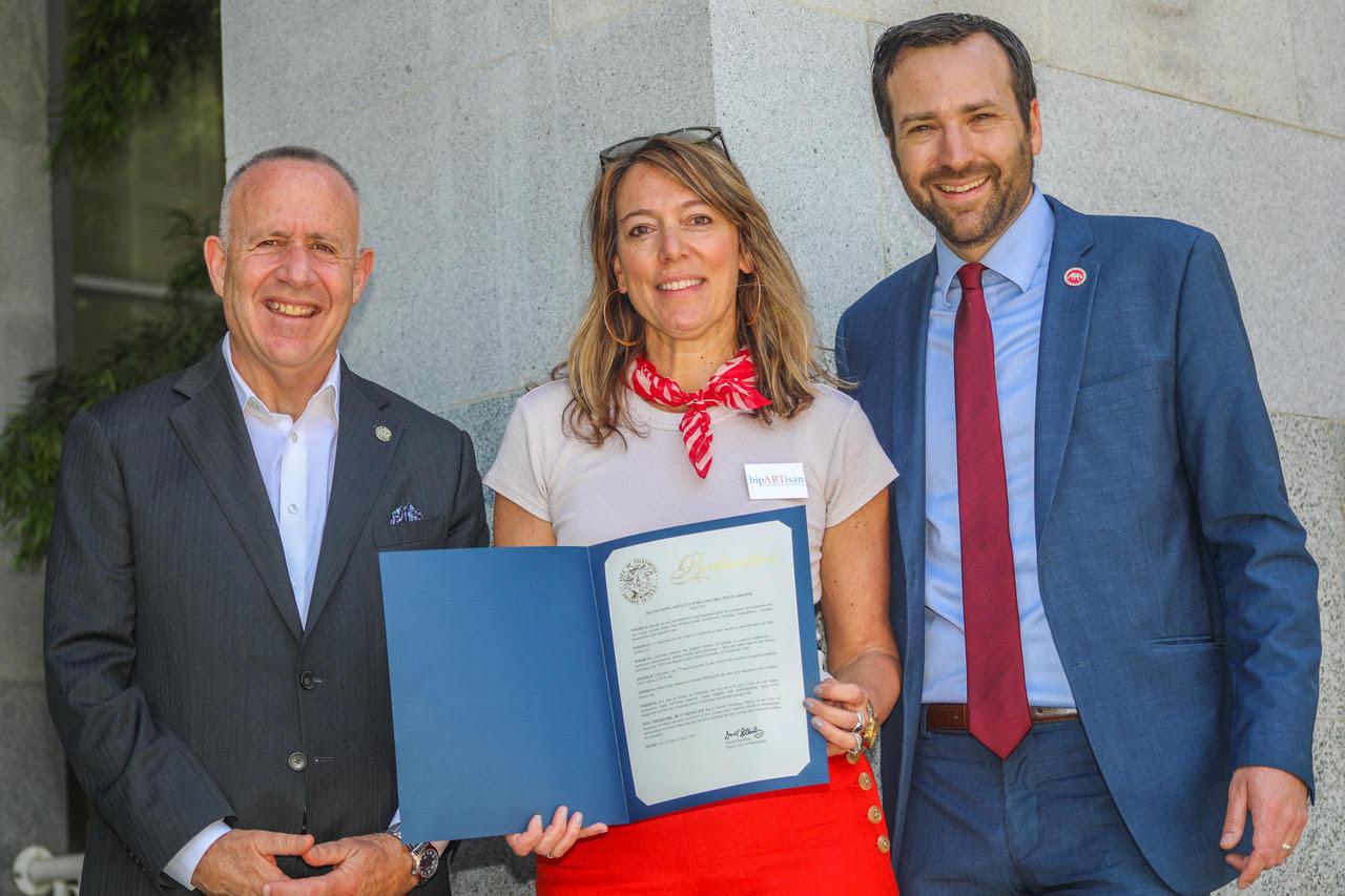 Sacramento Mayor Darrell Steinberg, Julie Baker and State Senator Ben Allen with a Sacramento Proclamation for Arts, Culture & Creativity Month.