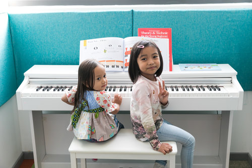 kids at piano blue bg.jpg