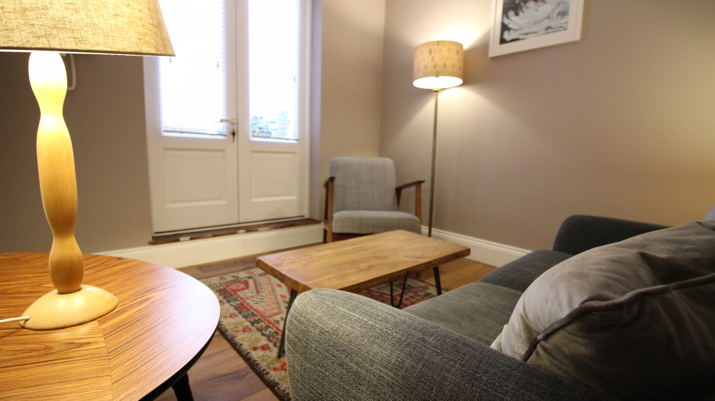library - A lovely room with natural light, the Library has a sofa, armchair and patio doors onto the courtyard area.