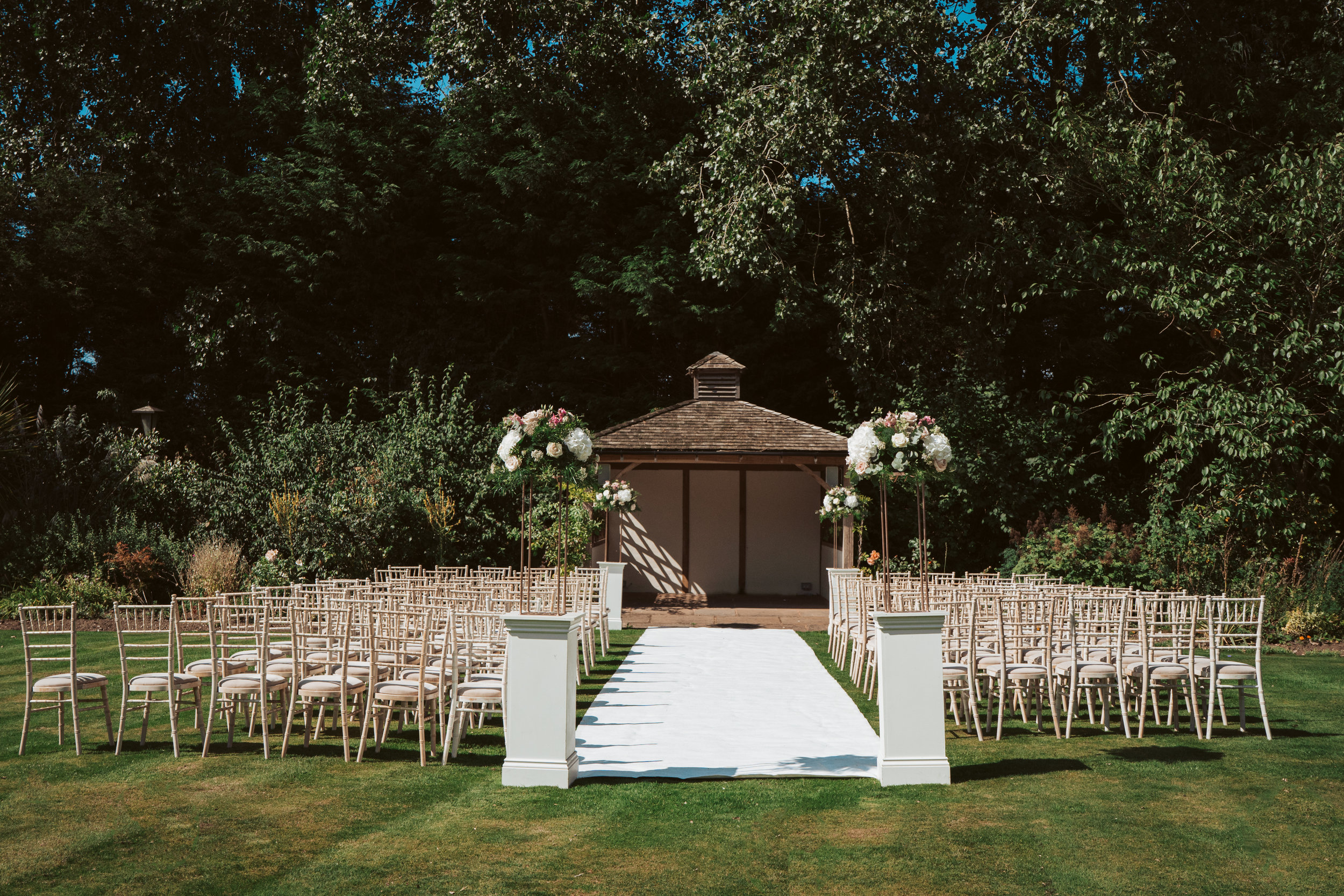 The Rose Pagoda - Our romantic Rose Pagoda enjoys an idyllic outdoor setting in the private secluded grounds, a memorable place under which to say your vows.