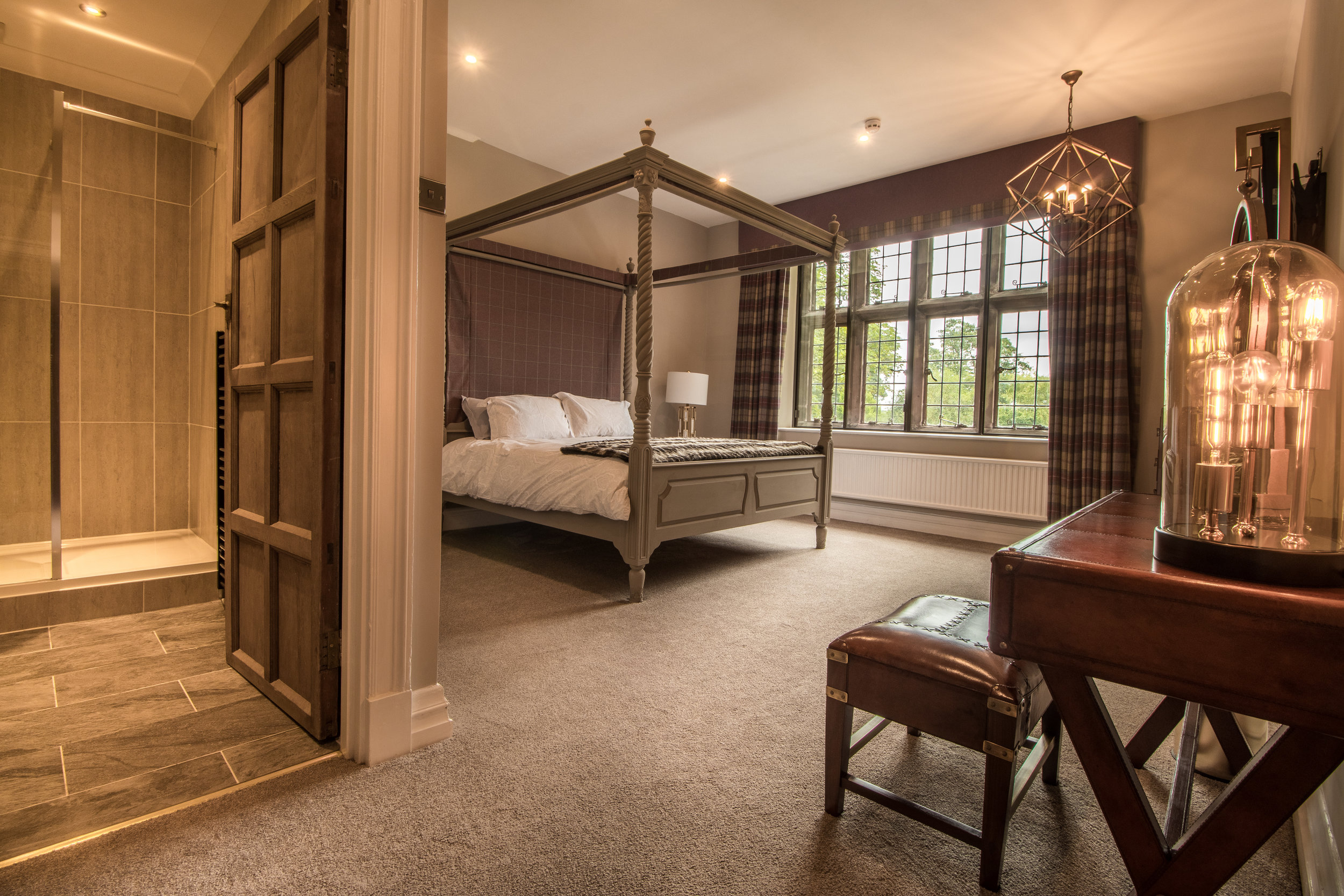 The Oulton & Warenberie - These two lavishly designed rooms, feature contemporary bespoke furnishing and original artwork. Located in the Main Hall, both enjoy stunning views of the gardens.