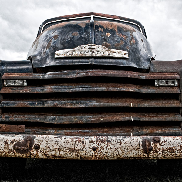HR08 Rusty Chevy. Colour abstract photograph of a 1952 Chevrolet 3100 by fine art photographer Paul Coghlin. Limited edition photographic prints.