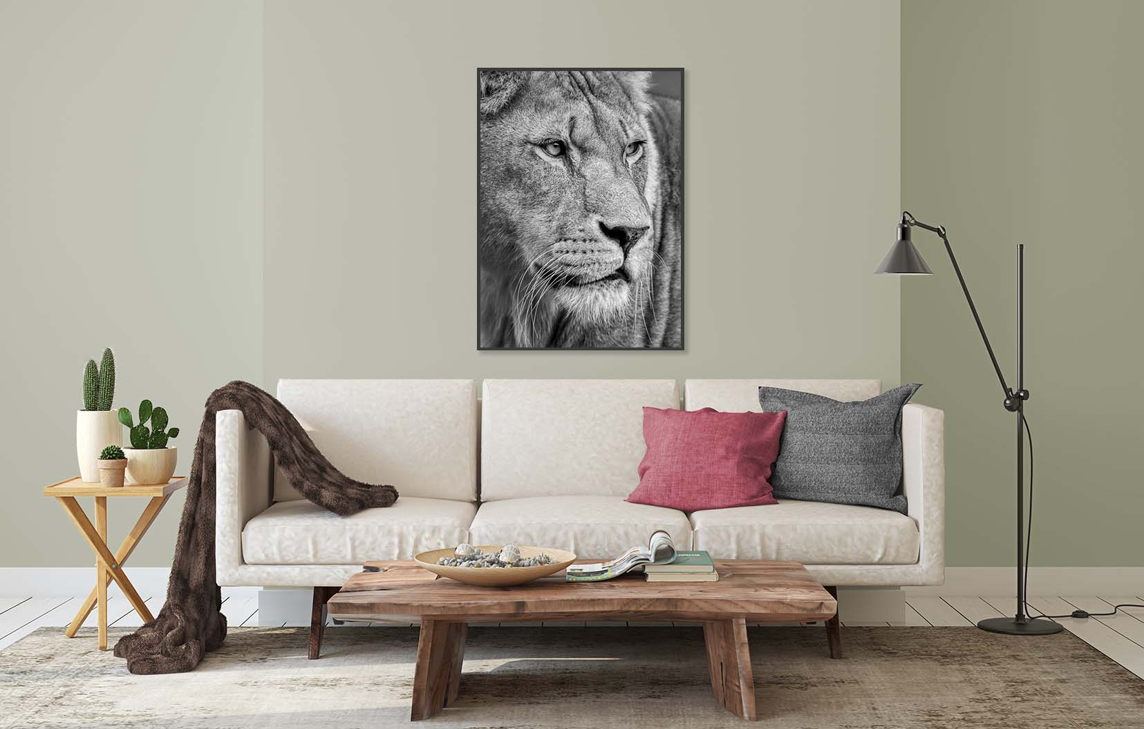 Black and white print of a Lioness watching shown on the wall in a living room. Limited edition photographic print by fine art photographer Paul Coghlin.