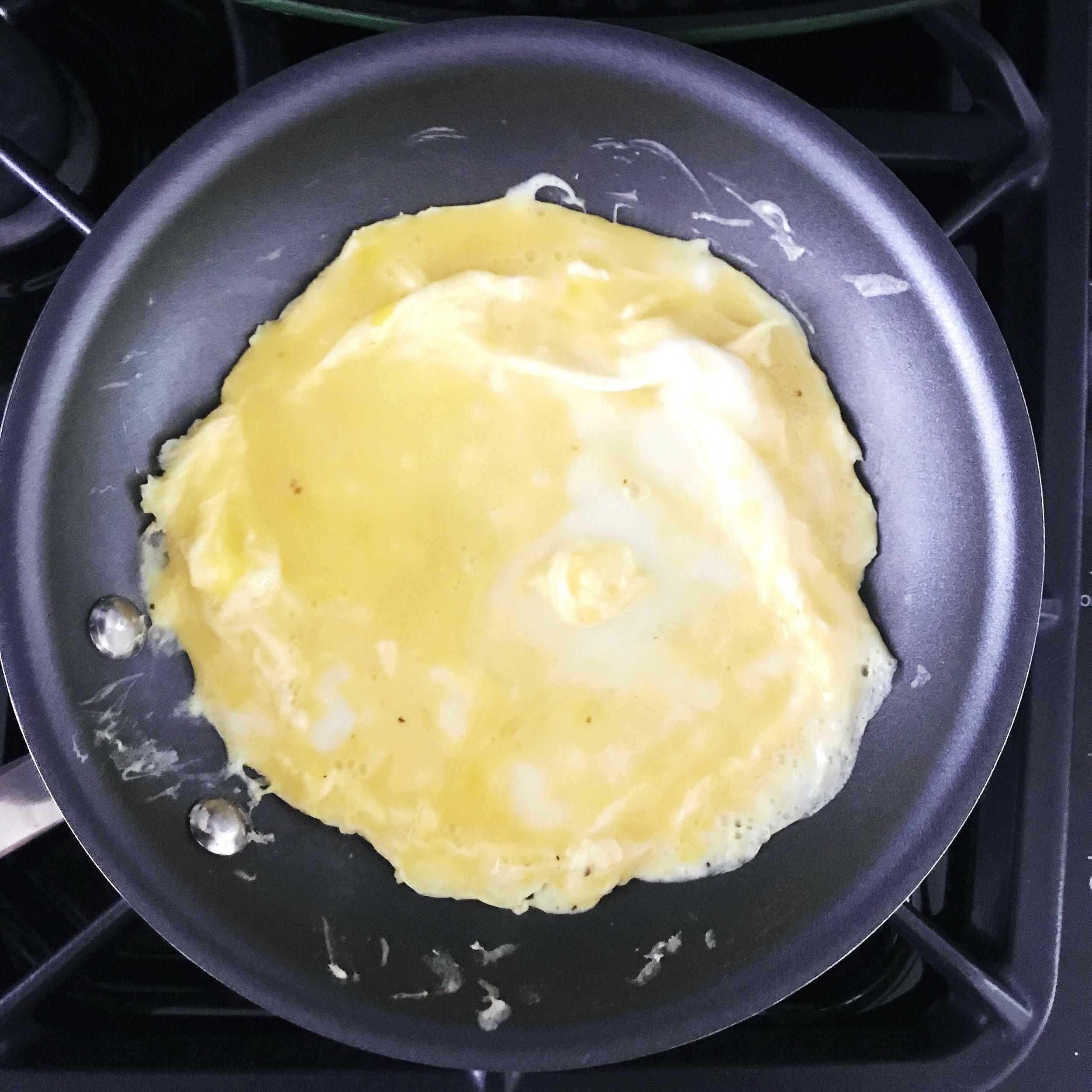 Eggs to Skillet.JPG