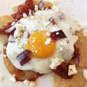 Easy chilaquiles are a Mexican brunch favorite with tortilla chips, salsa, and eggs | protopantry.com