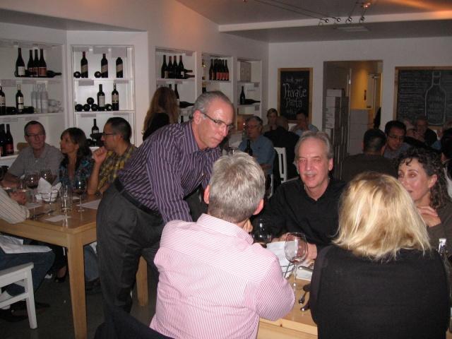 Michael Mondavi (standing) of Mondavi Family Winery