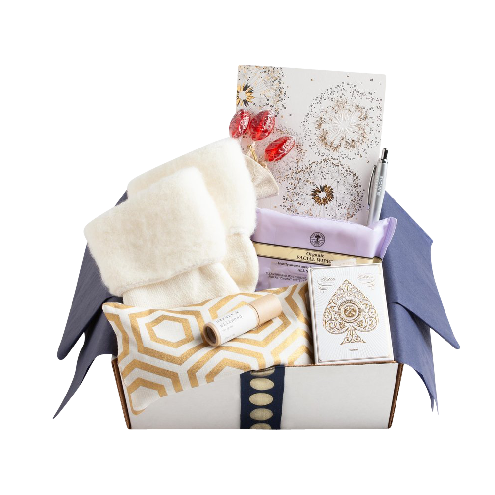 Carton Ivory - Carton Blanche $98.00Receiving a care package is an instant pick-me-up, especially when it's as practical and luxurious as this one from Carton Blanche. Brimming with essentials including a lavender-scented eye pillow, ridiculously cozy socks, rosy lip tint, organic facial wipes, elegant playing cards, and more, this is just one of the many incredible cartons to choose from. It's a gift you can be proud to send and one your loved one will be glad to have received.