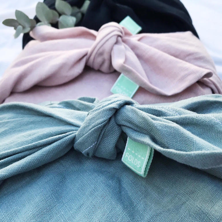 FOLDS certified linen gift wrap in  aquamarine ,  dusky pink  and  deep navy .