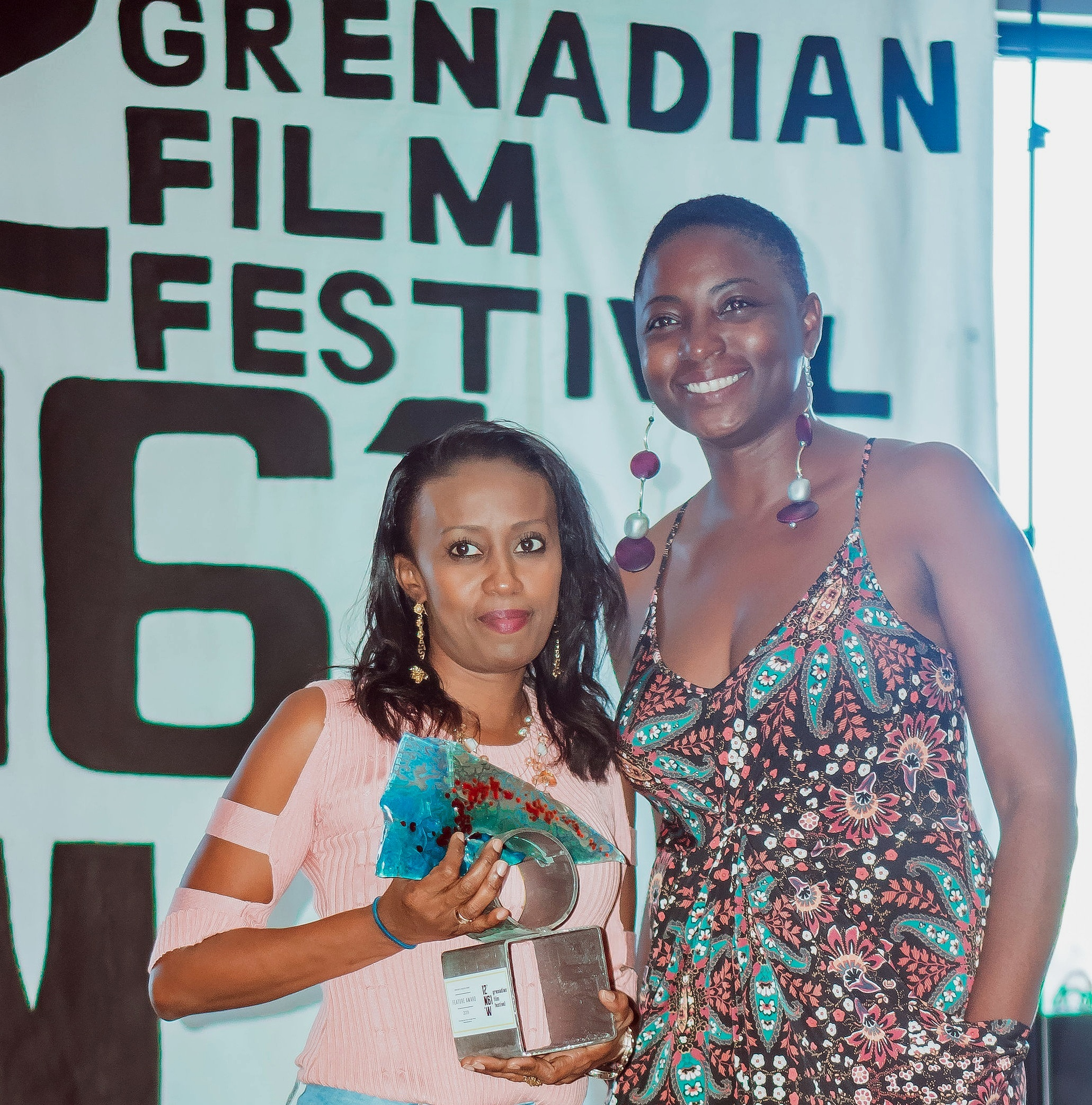 "(L-R) Camika Mc Letchie, receiving the award for ""Breaking the Cycle"" and Meschida Philip, 1261GFF Festival Director. Photo by Wayne Williams"